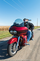 Mandy and Brett Schaible of the Old Cronies in Leola, SD riding his Harley-Davidson Road Glide in the USS South Dakota submarine flag relay near Groton as it crosses South Dakota. USA. Sunday October 8, 2017. Photography ©2017 Michael Lichter.