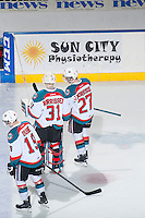 KELOWNA, CANADA - FEBRUARY 14: Josh Morrissey #27 and brother Jake Morrissey #31 of Kelowna Rockets skate to the dressing room after the game against the Moose Jaw Warriors on February 14, 2015 at Prospera Place in Kelowna, British Columbia, Canada.  (Photo by Marissa Baecker/Shoot the Breeze)  *** Local Caption *** Josh Morrissey; Jake Morrissey;
