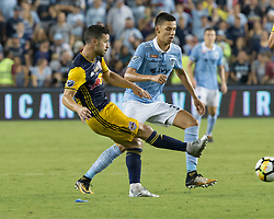 September 20, 2017 - Kansas City, Kansas, U.S - NY Red Bulls midfielder Felipe #8 (front) toe tackles the defense against Sporting KC forward Daniel Salloi #30 (behind) during the second half of the game. Sporting KC will win the 2017 Lamar Hunt Open Cup championship with a score of 2-1 over the New York Red Bulls. (Credit Image: © Serena S.Y. Hsu via ZUMA Wire)