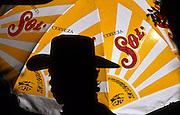 16 JANUARY 2002, GUANAJUATO, GUANAJUATO, MEXICO: A musician's silhoutte is cast against a beer umbrella in Plaza Union Jardin in the city of Gunajuato, state of Guanajuato, Mexico, Jan. 16, 2002.  .PHOTO BY JACK KURTZ
