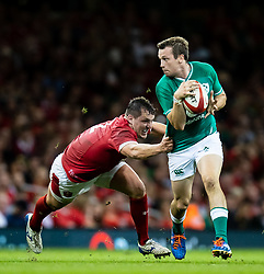 Jack Carty of Ireland under pressure from Ryan Elias of Wales<br /> <br /> Photographer Simon King/Replay Images<br /> <br /> Friendly - Wales v Ireland - Saturday 31st August 2019 - Principality Stadium - Cardiff<br /> <br /> World Copyright © Replay Images . All rights reserved. info@replayimages.co.uk - http://replayimages.co.uk