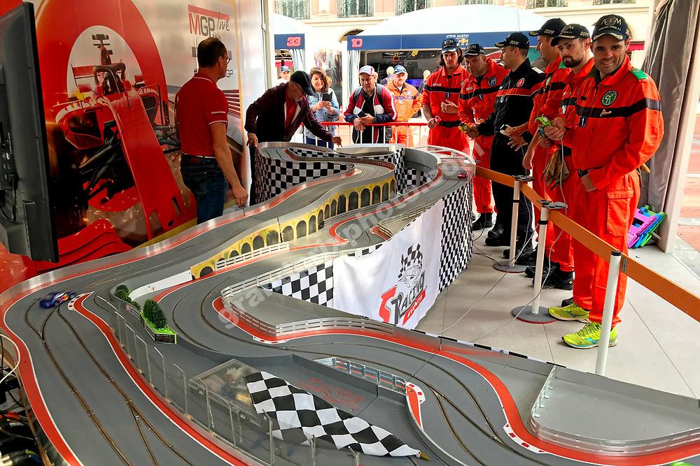 Marshalls playing with cars before the 2019 Monaco Grand Prix. Photo: Grand Prix Photo