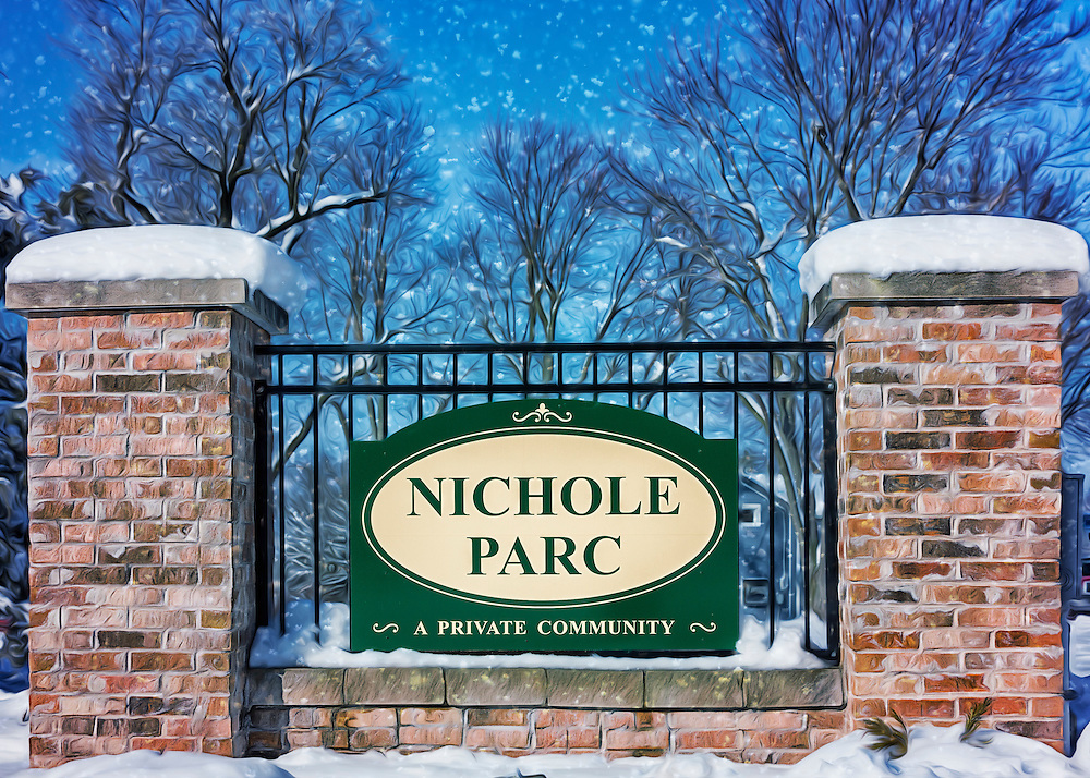 Snow falls at the entrance to the Nichole Parc subdivision in Wentzville, Missouri