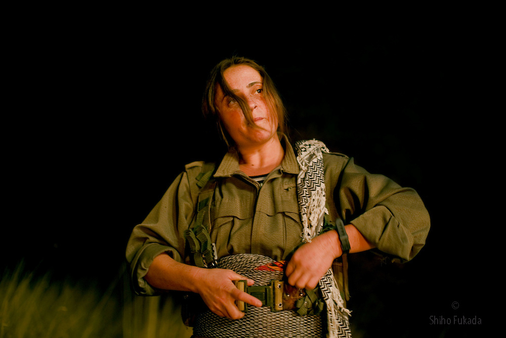 PKK member Muxayla Nergiz, 27, from Urfa in Turkey, puts on her gear before shooting a film about their struggle in Qandil Mountains, Iraqi Kurdistan. She joined PKK in 1999.
