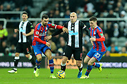 Jonjo Shelvey (#8) of Newcastle United on the ball under pressure from James McArthur (#18) of Crystal Palace and James McCarthy (#22) of Crystal Palace during the Premier League match between Newcastle United and Crystal Palace at St. James's Park, Newcastle, England on 21 December 2019.