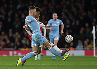 Football - 2019 /2020 FA Cup - Third Round: Arsenal vs. Leeds United.<br /> <br /> Ben White (Leeds United) clears in front of Joe Willock (Arsenal FC) at the Emirates Stadium<br /> <br /> COLORSPORT/DANIEL BEARHAM