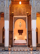 A bedroom of a luxury hotel, converted from a Dar, a traditional house, in the evening in Fes, Morocco