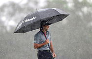Jason Day, of Australia, waits to putt during a downpour on the 14th green during the third round of the Arnold Palmer Invitational golf tournament in Orlando, Fla., Saturday, March 19, 2016. (AP Photo/Willie J. Allen, Jr.)