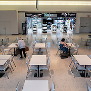 The food court at the JetBlue terminal at JFK Airport remains sparse during the Phase 4 reopening on Wednesday August 5, 2020 in New York, New York. Mayor de Blasio is asking travelers from 34 states and Puerto Rico, where COVID-19 infection rates are high, to quarantine for 14 days after arriving in the city.  (Alex Menendez via AP)
