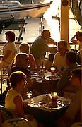 USA, Newport, RI - Sunset illuminates dining at the Clarke Cooke house