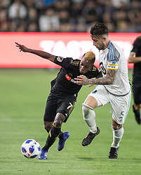 May 9, 2018 - Los Angeles, California, U.S - Latif Blessing #7 of the LAFC battles for the ball with Francisco Calvo #5 of the Minnesota United FC on Wednesday May 9, 2018, at the Banc of California Stadium in Los Angeles, California. LAFC defeats Minnesota United FC, 2-0. (Credit Image: © Prensa Internacional via ZUMA Wire)