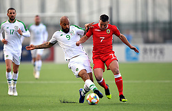 Republic of Ireland's David McGoldrick (left) and Gibraltar's Lee Casciaro (right) battle for the ball during the UEFA Euro 2020 Qualifying, Group D match at the Victoria Stadium, Gibraltar.
