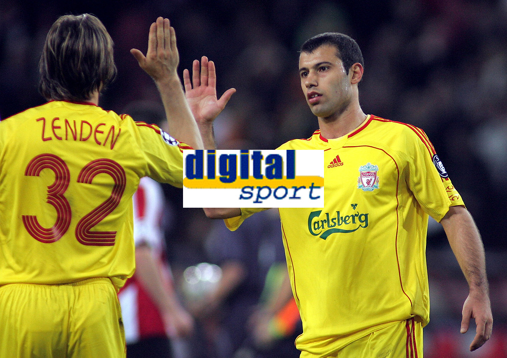 Photo: Paul Thomas.<br />PSV Eindhoven v Liverpool. UEFA Champions League, Quarter Final, 1st Leg. 03/04/2007.<br /><br />Javier Mascherano (R) of Liverpool gives team-mate Bolo Zenden a high five after the final whistle.