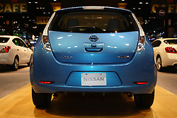 "08 February 2012:  2012 NISSAN LEAF: As a 100-percent electric powered, medium-size hatchback, the Nissan Leaf is based on a lithium-ion battery-powered chassis, and offered for 2012 in Leaf SV and Leaf SL trim packages. The battery powers a high-response 80kW AC synchronous motor, rated at 107 horsepower and 207 lb-ft of torque, which drives the front wheels through a single speed reducer. When equipped with a quick charge port and using a DC fast charger, the Leaf can be charged up to 80 percent of its full capacity in 30 minutes. Charging at home through a 220V outlet takes approximately eight hours, and the Leaf has a range of 100 miles on one full charge to satisfy real-world consumer requirements. The advanced lithium-ion battery pack carries an industry-competitive warranty of 8 years or 100,000 miles. Now in its second year of production, the Leaf's latest features include a photovoltaic solar panel spoiler that supports charging of the accessories 12-volt battery, and an ""Approaching Vehicle Sound for Pedestrians"" system. The Leaf offers comfortable seating for five adults, and with the 60/40 split folding rear seat lowered, 24.0 cu. ft. of cargo room. Chicago Auto Show, Chicago Automobile Trade Association (CATA), McCormick Place, Chicago Illinois"