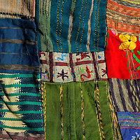 Central America, Guatemala, Typical Guatemalan textile - fabric scraps of various colors and textures forming a quilt.