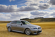BMW 5 Series silver grey M550i sport car, Cotswolds, Oxfordshire, United Kingdom