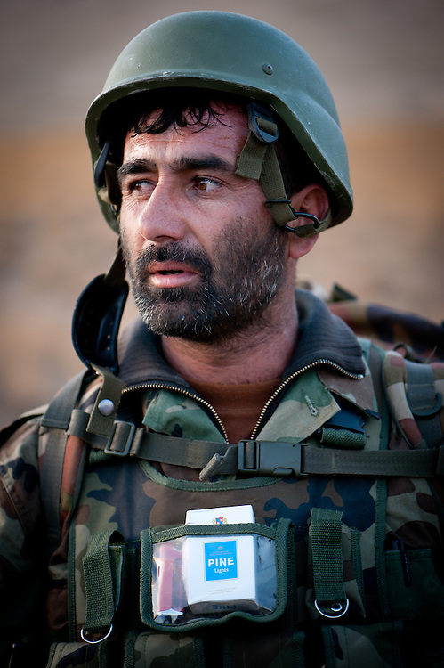 Forty year-old Captain Gholam Mojatba, a Tajik from the northern province of Panshir, on patrol in the Depak Valley. Captain Mojatba joined the mujahideen to fight the Soviet occupation as a teenager and now leads a company of Afghan National Army soldiers in the fight against the Taliban.