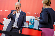 German Minister of Finance and SPD Chancellor candidate Olaf Scholz (L) gestures towards SPD top candidate for the position of Berlin's Governing Mayor Franziska Giffey during an elections campaign event in Berlin, Germany, September 03, 2021. The German Federal elections are scheduled to take place on September 26, 2021.