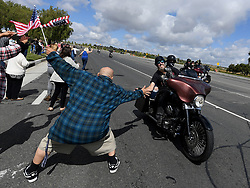 May 27, 2019 - Riverside, California, U.S. - Richard Sevier, from Riverside, greets riders in the 20th anniversary West Coast Thunder bike run Monday, May 27, 2019 as they ride past Riverside National Cemetery in observance of Memorial Day. (Credit Image: © Will Lester/SCNG via ZUMA Wire)