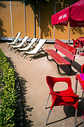 Deckchairs, red chairs and a bench at the cafe at the Jardim Botânico do Porto in Porto, Portugal. The Jardim Botânico do Porto is a botanical garden located in the gardens of the Campo Alegre Estate and acquired by the Portuguese state in 1949.