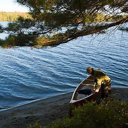 A man readies his canoe on Seboeis Lake near Millinocket, Maine.