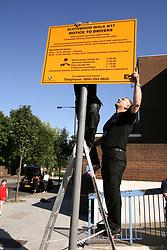 Parking sign being erected in London Borough of Haringey Scotswood Walk housing estate