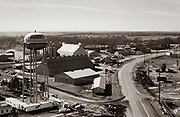 Aerial photograph of Plains, Georgia in 1976 as Jimmy Carter wins the US presidential election. Carter Warehouse and a trailer - based broadcast center - nicknamed TV City - stands under the red, white and blue water tower.