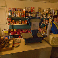 North of the Arctic Circle in Russia, a shopkeeper tends her store in Snopa village, which is primarily occupied by ethnic Russians, but where the nomadic Komi reindeer herders also periodically procure fresh food, staples and vodka.
