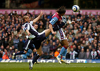 Photo: Glyn Thomas.<br />Aston Villa v West Bromwich Albion. The Barclays Premiership. 09/04/2006.<br /> West Brom's Nigel Quashie (L) aims for the ball but catches Milan Baros in the face.