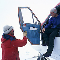 ANTARCTICA.  Pilot Greg Stein emerges from Twin Otter after harrowing white-out landing at Patriot Hills expedition base.