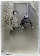 eroding glass plate with adult and elderly women posing