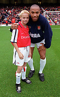 Thierry Henry with the Arsenal mascot. Arsenal v Aston Villa. FA Premiership, 14/10/00. Credit: Colorsport.