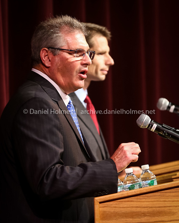 (10/15/14, NATICK, MA) At left, incumbent David Linsky, D-Natick, delivers some remarks during the debate with Republican challenger Doug Grindle, a Natick resident, at Natick High School on Wednesday. The Natick Forever Political Action Committee sponsored the debate for candidates in the 5th Middlesex state representative race. Daily News and Wicked Local Photo/Dan Holmes