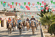 Mexican cowboys arrive to camp at a village stop along the road during the annual Cabalgata de Cristo Rey pilgrimage January 4, 2017 in La Sauceda, Guanajuato, Mexico. Thousands of Mexican cowboys and horse take part in the three-day ride to the mountaintop shrine of Cristo Rey stopping along the way at shrines and churches.