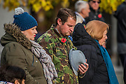 Peopel in the street outside stand silent in respect - The Duke of Edinburgh, Life Member, Royal British Legion, accompanied by Prince Harry, visit the Field of Remembrance at Westminster Abbey  - 10 November 2016, London.