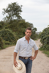 handsome man on a dirt road