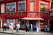 Crispins Food Hall on Shaftesbury Avenue, a convenience store in central London. West End musical shows are advertised above the shop.