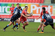 Gareth Davies of the Scarlets © looks for a gap. Guinness Pro12 rugby match, Scarlets  v Cardiff Blues at the Parc y Scarlets in Llanelli, West Wales on Saturday 2nd April 2016.<br /> pic by  Andrew Orchard, Andrew Orchard sports photography.