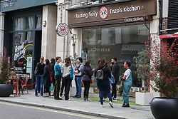 © Licensed to London News Pictures. 31/08/2020. London, UK. Members of the public queue outside Enzo's Kitchen, an Italian restaurant in central London as the government's Eat Out to Help Out scheme comes to an end today. Eat Out to Help Out was introduced by the Chancellor RISHI SUNAK to help boost  pubs and restaurants following the easing of COVID-19 lockdown. Under the scheme, restaurants offered customers half price food and soft drinks on Mondays, Tuesdays and Wednesdays during August and recouped the cash, up to a maximum of £10, from the government. Photo credit: Dinendra Haria/LNP