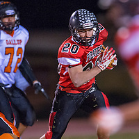 110113       Cable Hoover<br /> <br /> Grants Pirate Rosendo Jaramillo (20) weaves through the Gallup Bengals defense Friday at Grants High School.