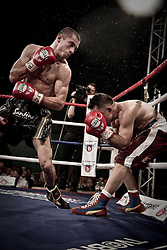Scott Quigg backs up tough opponent Franklyn Varela at the Castle Leisure Centre in Bury.