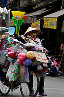 Vendors sell everything imagineable on the back of bicycles in the streets of the old quarter in Hanoi.