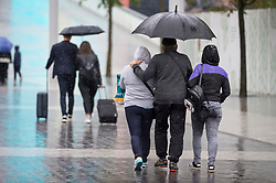 © Licensed to London News Pictures. 16/08/2018. LONDON, UK.  People caught in heavy rain at Wembley Park in north west London.  Photo credit: Stephen Chung/LNP