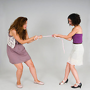 Two women against each other in a Tug of War