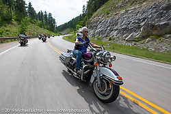 Cheryl O'Brien on the Cycle Source ride down Vanocker Canyon back from Nemo to the Iron Horst Saloon during the Sturgis Black Hills Motorcycle Rally. SD, USA. Wednesday, August 7, 2019. Photography ©2019 Michael Lichter.