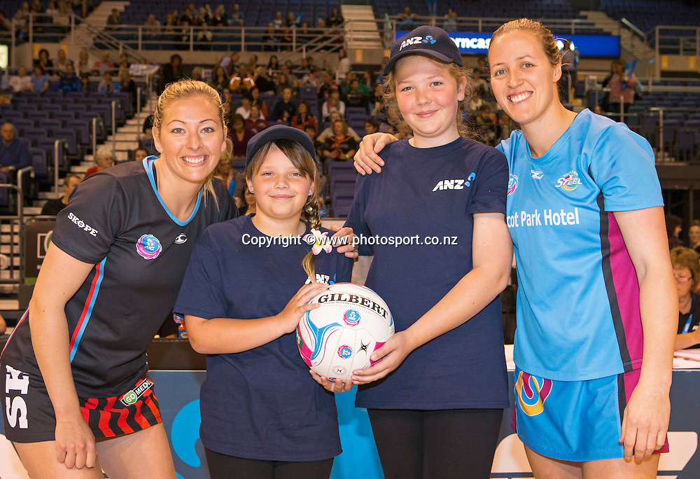 Anna Thompson Tactix captain and Wendy Frew Steel captain with ANZ Future Captains Emily Harris and Jess Hunter-Brady before the ANZ Championship Netball game between the Tactix v Steel at Horncastle Arena in Christchurch. 6th April 2015 Photo: Joseph Johnson/www.photosport.co.nz