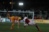 Newport's Max Porter (l) clashes with Fleetwood's  Jamille Matt.  Skybet football league 2 match, Newport county v Fleetwood Town at Rodney Parade in Newport, South Wales on Tuesday 4th March 2014.<br /> pic by Andrew Orchard, Andrew Orchard sports photography.