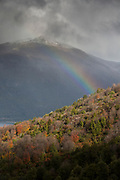 View of rainbow over Camino el Frey covered with clouds in Bariloche, Argentina
