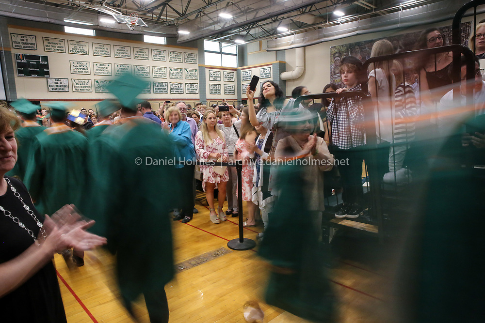 (5/31/19, HOPKINTON, MA) Family and friends greet graduates during graduation at Hopkinton High School on Friday. [Daily News and Wicked Local Photo/Dan Holmes]