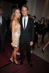 JENSON BUTTON and JESSICA MICHIBATA at the annual GQ Awards held at the Royal Opera House, Covent Garden, London on 8th September 2009.